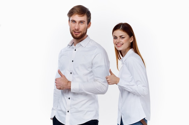 Business finance employees at work man and woman in identical shirts