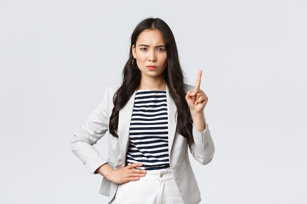 Business, finance and employment, female successful entrepreneurs concept. angry serious-looking businesswoman teaching employee lesson, shaking finger in prohibition, scolding person
