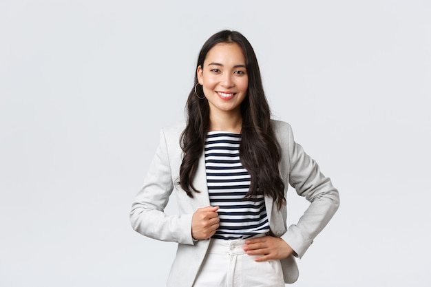 Business, finance and employment, female successful entrepreneurs concept. confident good-looking female office manager, lady in white jacket smiling and looking determined to win case in court.