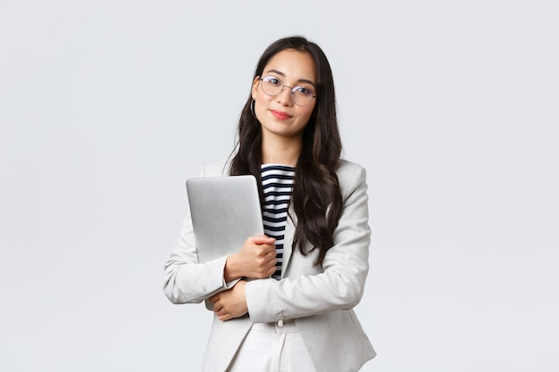 Business, finance and employment, female successful entrepreneurs concept. young asian businesswoman, bank clerk in glasses holding laptop