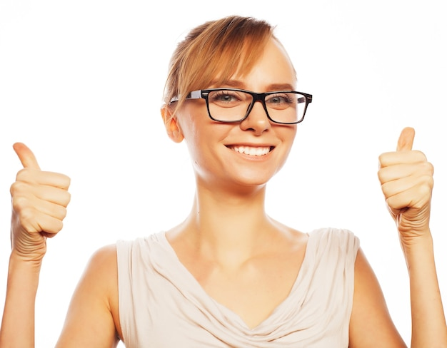 Business, finance and people concept: happy smiling business woman with thumbs up gesture