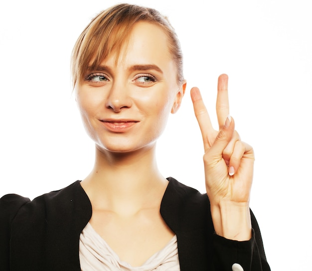 Business, finance and people concept: successful business woman showing victory sign. isolated on white.