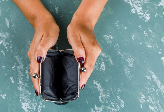 Business and financial concept. woman holding opened purse.