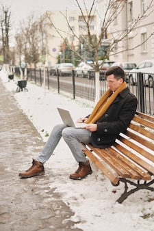 Business and freedom. modern businessman, laptop keyboard with a laptop on a bench and working,