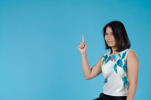 Business girl on blue background, portrait woman, asian girl
