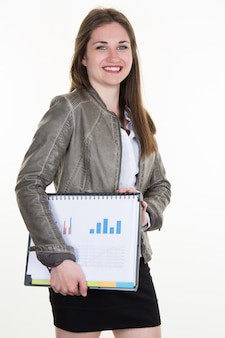 Business girl smiling holding reports and looking at camera.