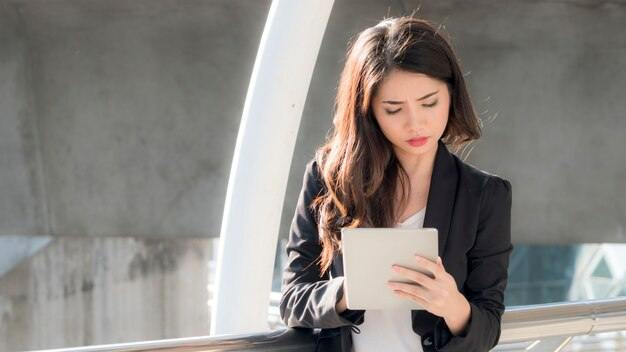 Business girl with smart tablet devices and city