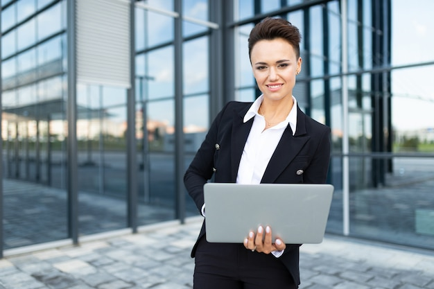 Business on the go, concept of young successful business lady, professional in company management