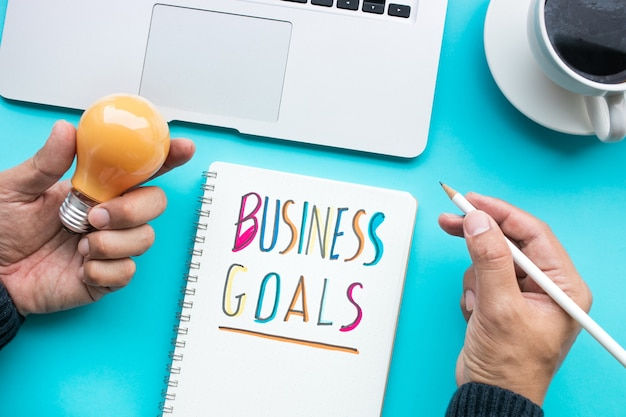Business goal and ideas creativity concepts with male holding light bulb