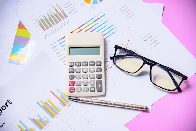 Business graph chart report paper financial document with calculator pen and glasses