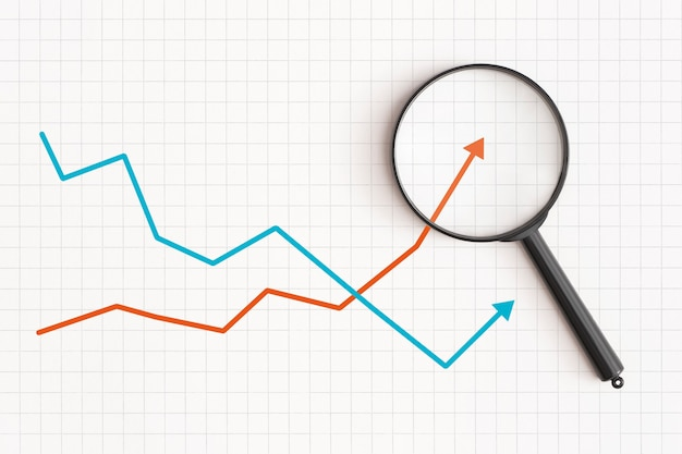 Business graph and magnifying glass on table financial development economy statistics