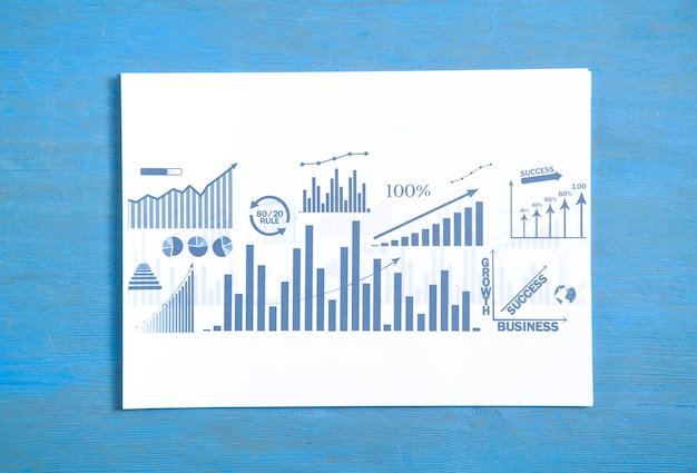 Business graphs on blue background