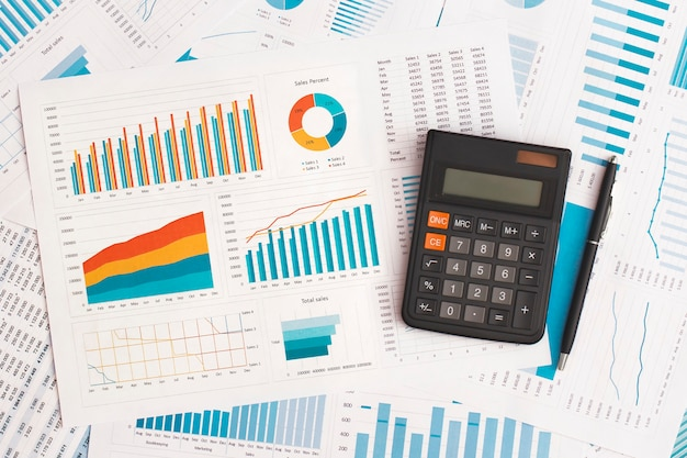 Business graphs charts and calculator on table financial development