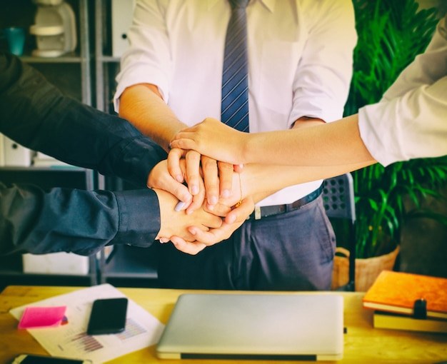 Business group hands together, joining teamwork concepts