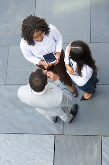Business group of three talking near office