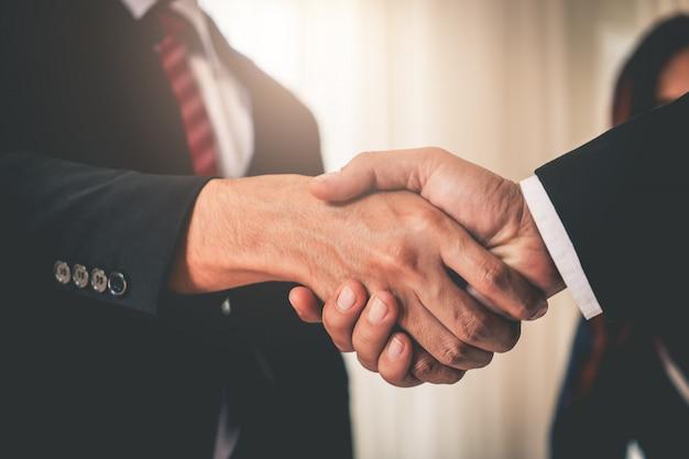 Business hand shake between corperate executive Premium Photo