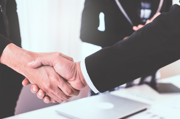 Business hand shake between corperate executive