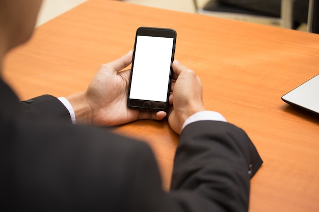 Business hand using phone white screen on top view