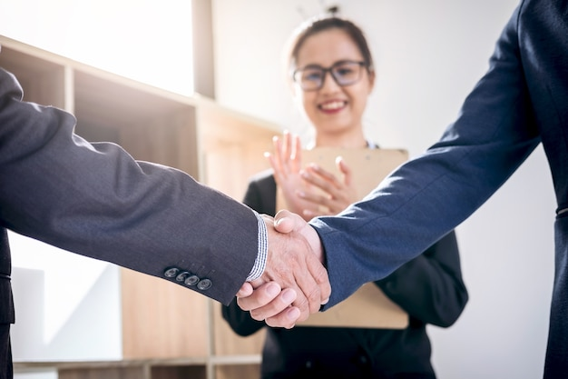 Business handshake after discussing good deal of trading contract for both companies