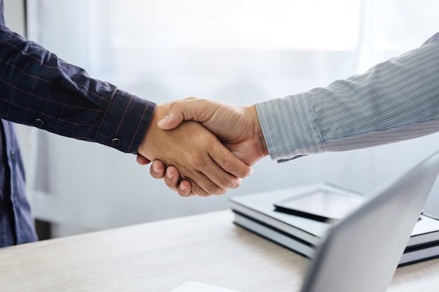 Business handshake and business people after discussing good deal of trading