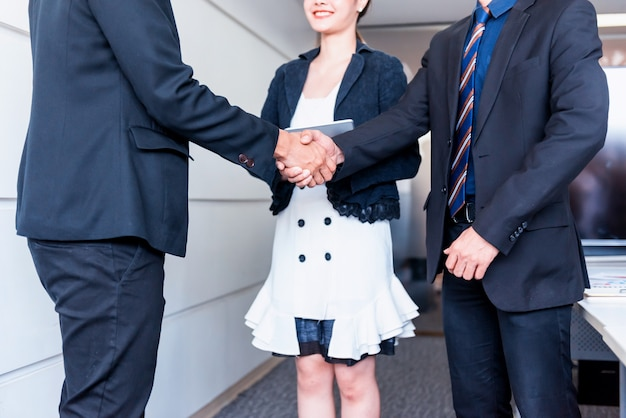 Business handshake corruption. teamwork for success and achievement goal