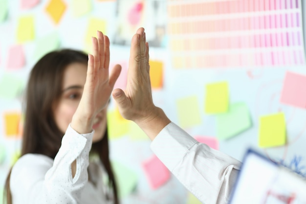 Business high-five at workplace