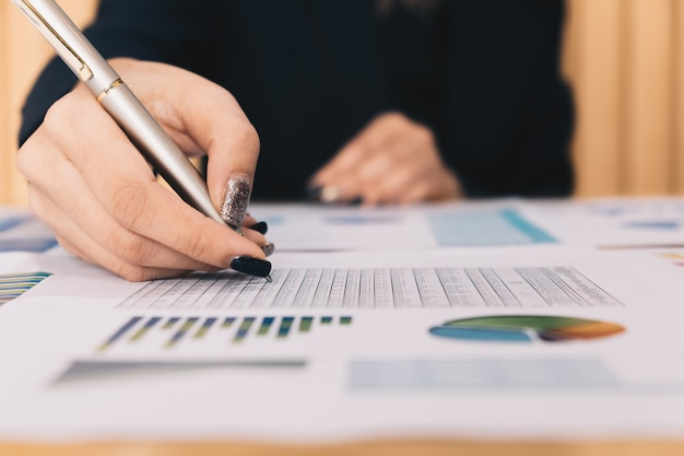 Business investment consultant analyzing company annual financial report balance sheet