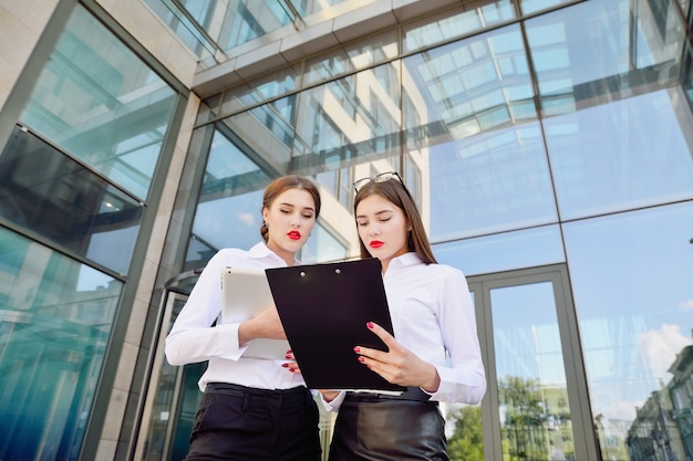 Business lady. office staff. two young girls