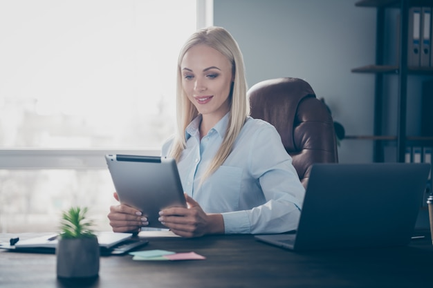 Business lady read corporate report tablet