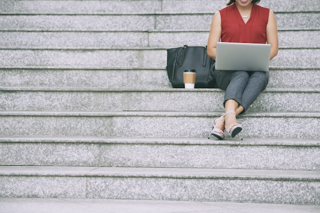 Business lady resting on stairs