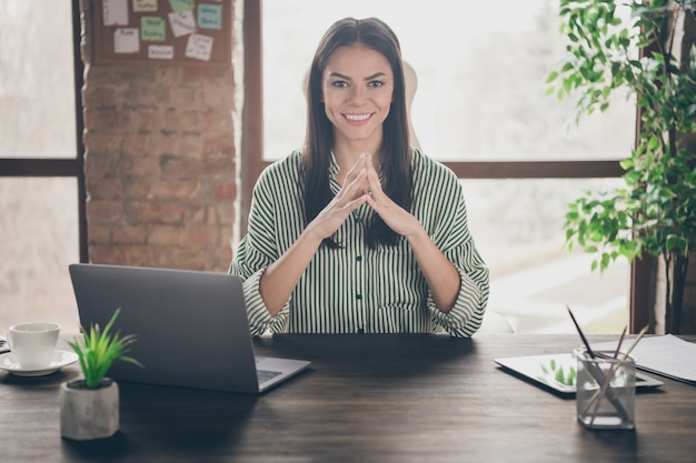 Business lady sit table at loft office holding fingers