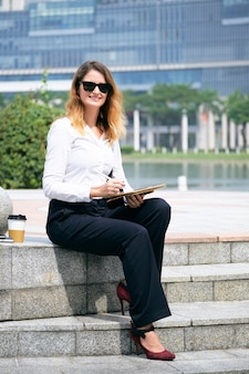 Business lady working in park