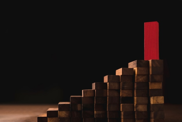 Business leadership  ideas concept with red wood block stand out from other brown block