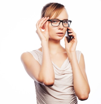 Business, lifestyle and people concept: young business woman wearing glasses with mobile phone.