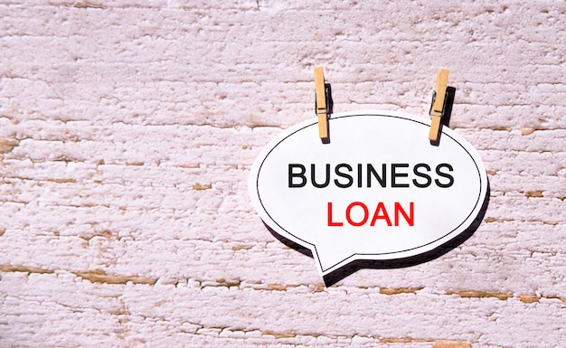 Business loan on a white bubble speech paper with wooden pins