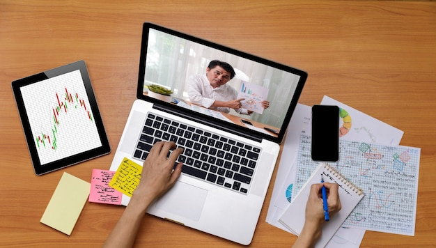 Business long distance video call, businessman and businesswoman analysis financial report using videoconference application for virtual communication
