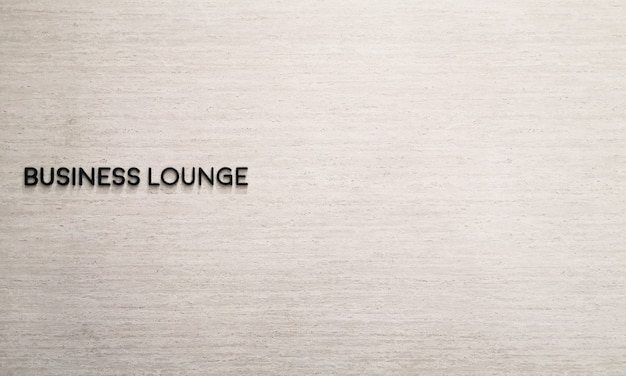 Business lounge label name on marble wall