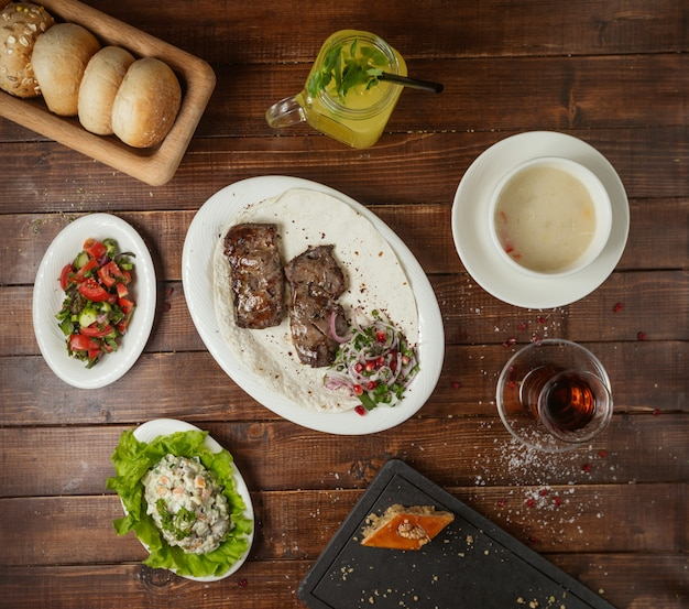 Business lunch with soup salad and meat kebab