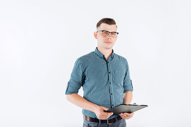 Business man in a blue shirt with a folder in hand