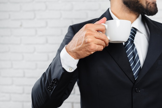 Business man in a business suit and a cup of coffee