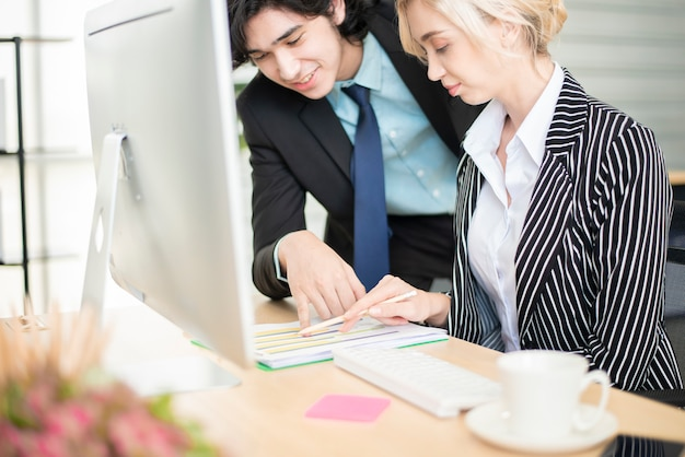 Business man and business woman are analytics business data, business plan