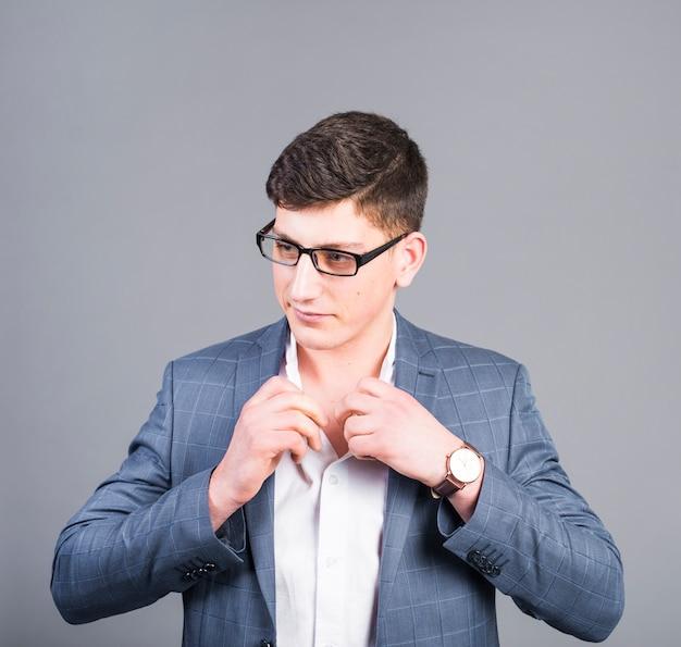 Business man buttoning shirt