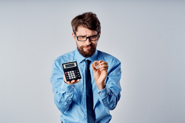 Business man calculator cryptocurrency bitcoin electronic money