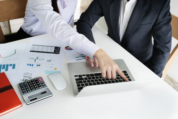 Business man consultant describes a marketing plan to set business strategies for women business owners. business budget planning and researching concept.