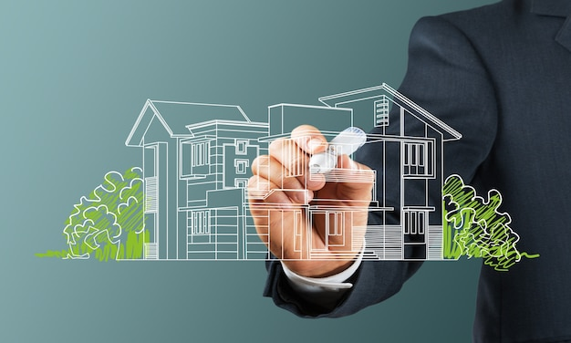 Business man drawing a house on background