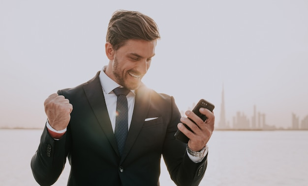Business man in dubai at sunset time Premium Photo
