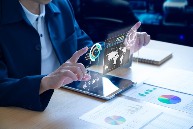 Business man expanding futuristic virtual screen over a modern tablet Premium Photo