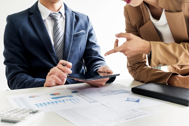Business man financial inspector and secretary making report, calculating or checking balance. internal revenue service inspector checking document. audit concept at working with plan on office