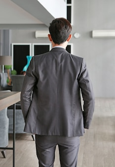 Business man from the back on workplace in office