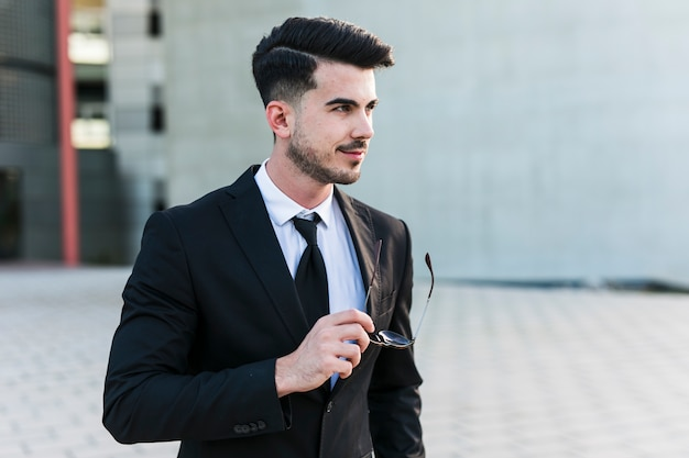 Business man in front of the office building